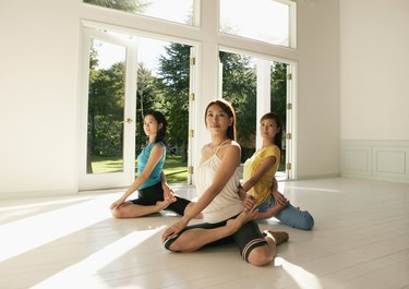 Three young women in yoga pose