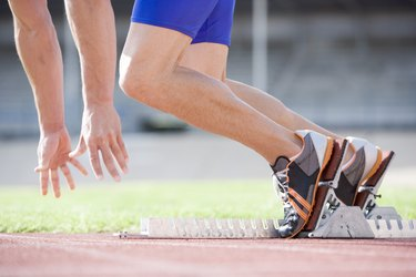 Athlete running out of starting blocks