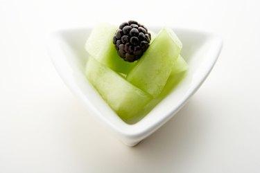 Blackberry on slices of honeydew