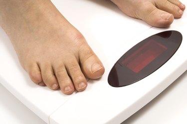 feet on white scale