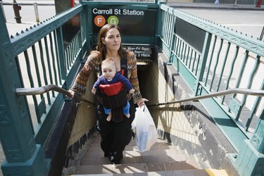 Mother and baby on subway steps