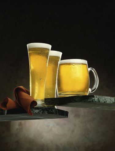 Two glasses and a mug of beer