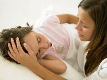 Woman comforting resting girl