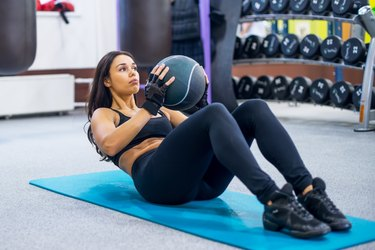 Work out fitness woman doing sit ups abs abdominal crunches