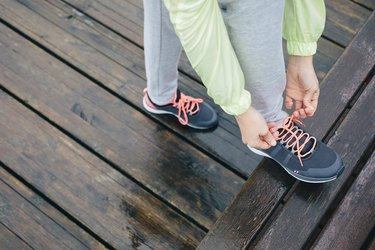 Woman lacing running sport shoes