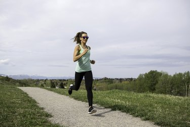 A woman running in a park.