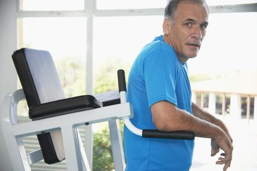 Mature man on exercise machine (portrait)