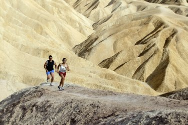 Man and woman running in desert
