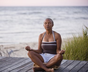 Senior African American woman meditating