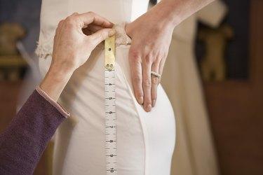 Seamstress adjusting dress