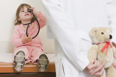 Girl playing with stethoscope