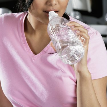 Close-up of a young woman drinking water