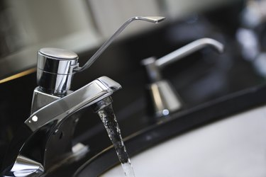 Water flowing from bathroom faucet