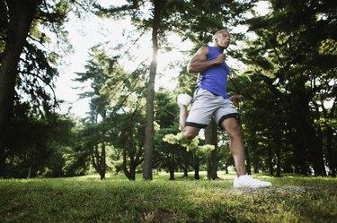 Man jogging through woods