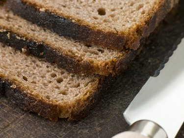 Slices of Rye Bread on a Chopping Board