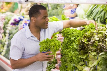 Man shopping for lettuce at a grocery store
