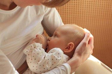 mother breastfeeding baby 1