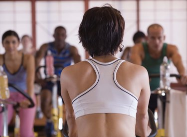 Rear view of instructor in spinning class