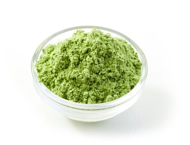 bowl of green wheat sprouts powder