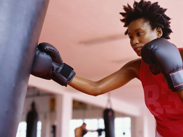Low angle view of a young woman practicing boxing