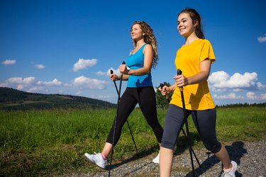 Healthy lifestyle - young women Nordic walking