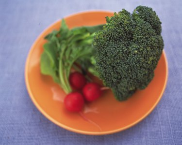 Closed Up Image of a Broccoli and Some Radish On an Orange Plate, High Angle View, Differential Focus