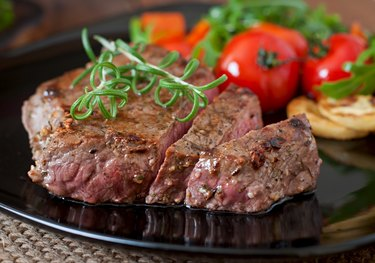 Closeup of grilled beef steak with vegetables
