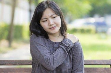 Woman: Shoulder Pain at Park