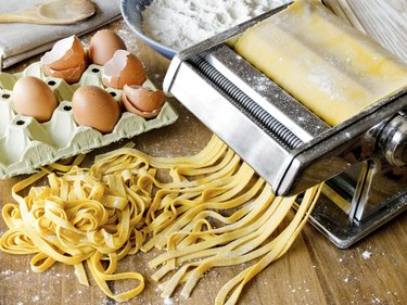 Fresh pasta cutting in machine.