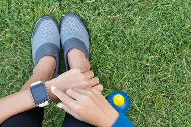 athletic woman using smartwatch on top view