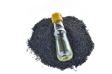 Black sesame seeds on a white background