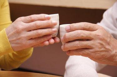 Senior couple toasting with tea