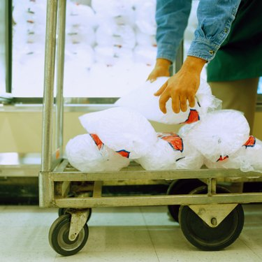 Man Unloading Bags of Ice