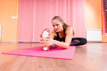 Determined Athletic Woman Stretching her Leg