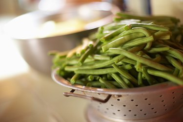 Fresh green beans in colander