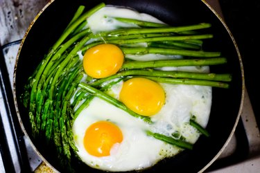 Eggs and asparagus in skillet