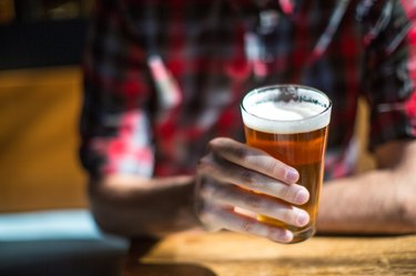 Man holds beer