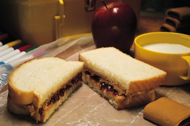 School lunch with peanut butter and jelly sandwich