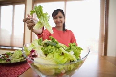 Hispanic woman eating salad