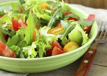 fresh healthy salad with tomatoes and arugula