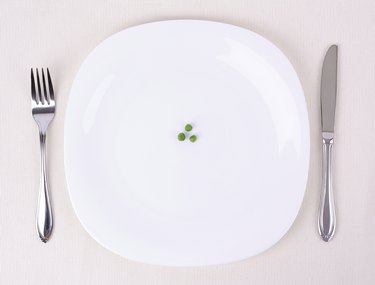 Small portion of food on a big plate