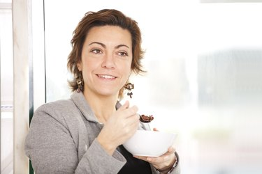 Businesswoman eating her breakfast