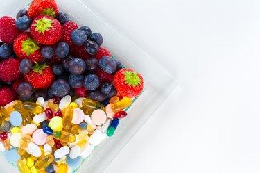 Healthy lifestyle, Fruit and pills, vitamin supplements with copy space