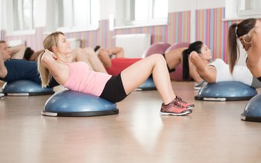 Abs exercise on bosu ball