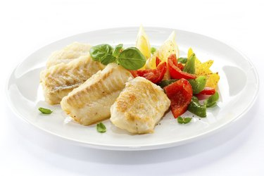 Fried cod fillets and vegetables