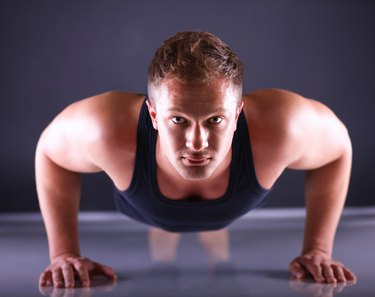 Fitness man doing push ups on floor