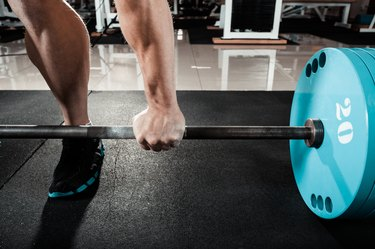 hand on the barbell