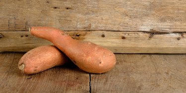 Sweet potato on the wooden background