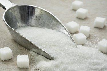 Sugar on metal scoop