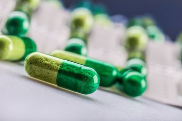 Pills. Tablets. Capsule. Heap of pills. Medical background.